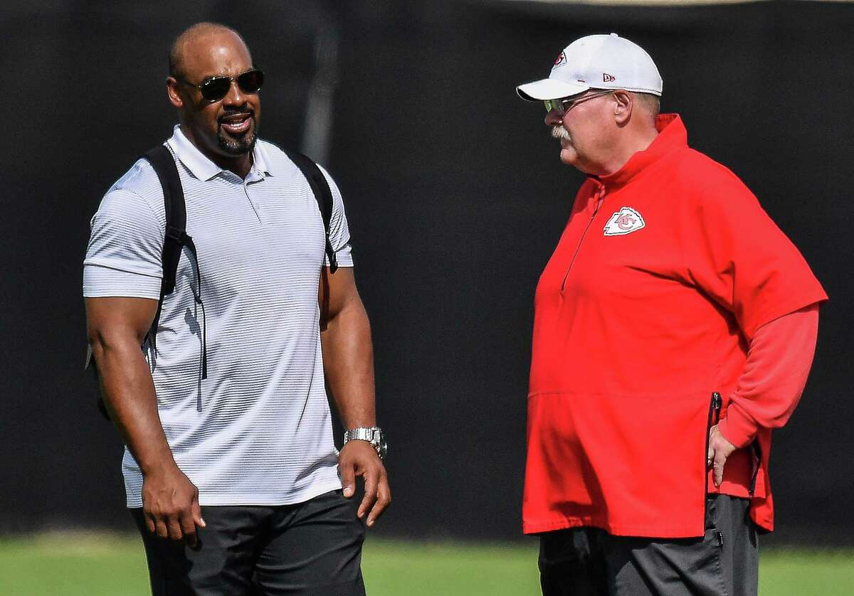 DAVIE, FLORIDA - JANUARY 30: Head Coach Andy Reid of the Kansas City Chiefs visits with former player Donovan McNabb during the Kansas City Chiefs practice prior to Super Bowl LIV at Baptist Health Training Facility at Nova Southern University on January 30, 2020 in Davie, Florida. (Photo by Mark Brown/Getty Images)