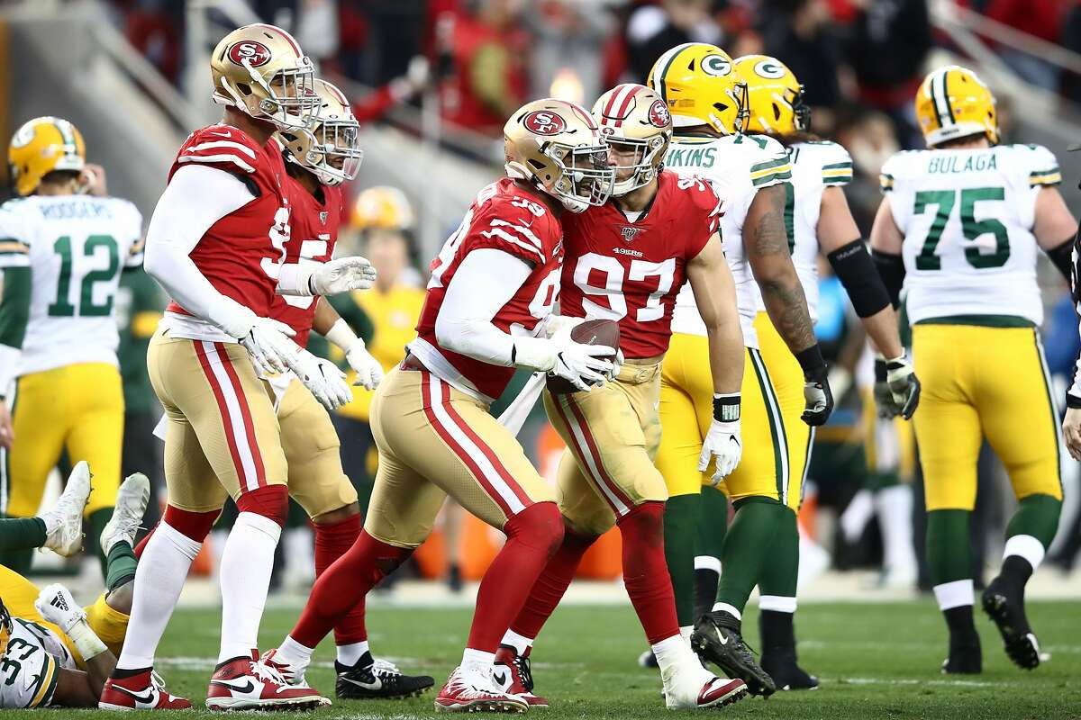 SANTA CLARA, CALIFORNIA - JANUARY 19: DeForest Buckner #99 celebrates a fumble recovery with Nick Bosa #97 of the San Francisco 49ers in the first half against the Green Bay Packers during the NFC Championship game at Levi's Stadium on January 19, 2020 in Santa Clara, California. (Photo by Ezra Shaw/Getty Images)
