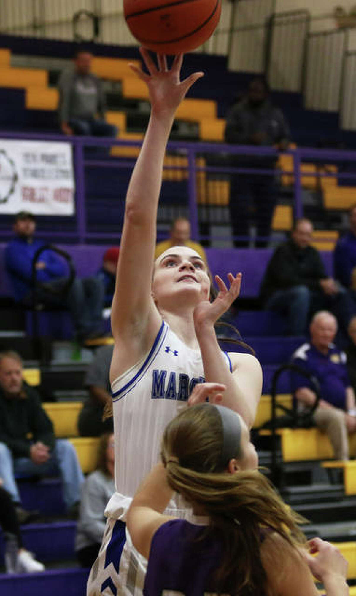 Marquette Catholic's Abby Williams shoots over a Breese Central defender during a game at the CM Shootout on Dec. 20 in Bethalto. Williams underwent surgery to repair a torn ACL on Thursday and will miss the rest of her sophomore season with the Explorers.