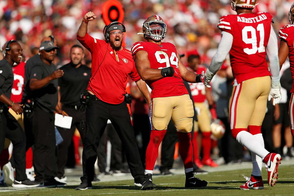 San Francisco 49ers' Solomon Thomas (94) defensive line coach Kris Kocurek react to an Arik Armstead sack of Los Angeles Rams' Jared Goff during Niners' 20-7 win in NFL game at Los Angeles Coliseum in Los Angeles, Calif., on Sunday, October 13, 2019.
