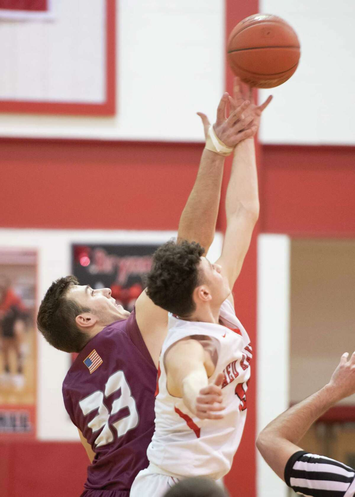 Mechanicville's Tyler Dion wins the tip-off from Stillwater's Brian McNeil during a game on Thursday, Jan. 30, 2020, in Mechanicville, N.Y. (Jenn March, Special to the Times Union )
