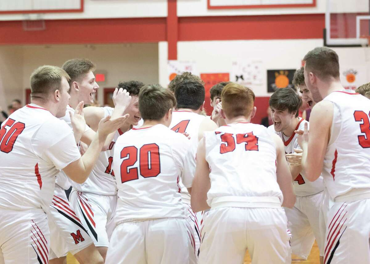 Mechanicville varsity boys basketball players rally prior to the start of a game against Stillwater on Thursday, Jan. 30, 2020, in Mechanicville, N.Y. (Jenn March, Special to the Times Union )