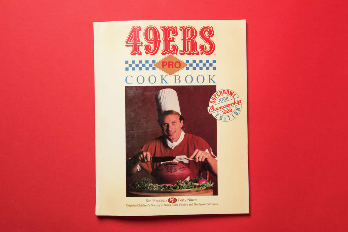 """A young Joe Montana graces the cover of the """"49ers Pro Cookbook,"""" a book sold to benefit a children's charity in Santa Clara County."""