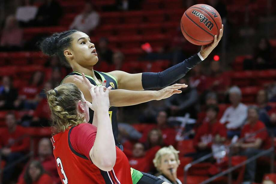 Satou Sabally, who scored a game-high 23 points, soars over Utah's Andrea Torres in the second quarter of No. 3 Oregon's 90-63 victory in Salt Lake City. Photo: Rick Bowmer / Associated Press