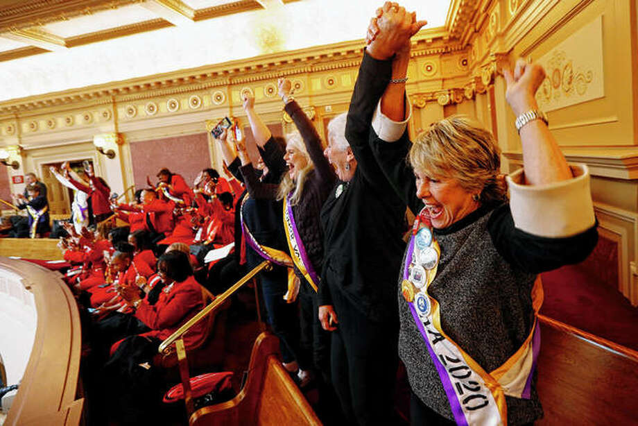 Equal Rights Amendment supporter Donna Granski (right) of Midlothian, Virginia, cheers the passage Monday of the House ERA Resolution in the Senate chambers at the Capitol in Richmond, Virginia. The resolution passed 27-12. Whether the amendment now is added to the U.S. Constitution is the subject of a lawsuit. Photo: Steve Helber | Associated Press