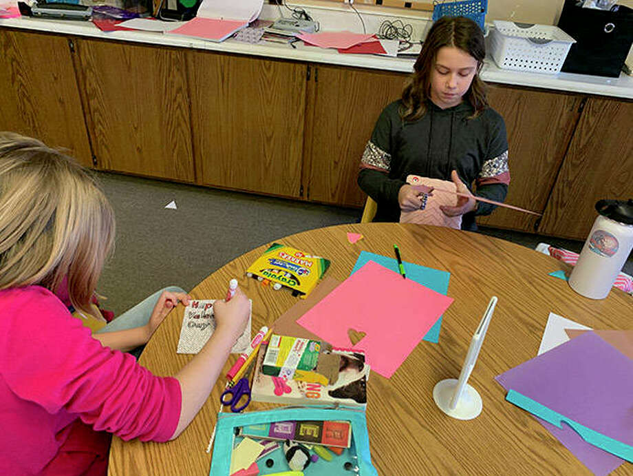 Zoe Niewohner and Adalyn Wagner create cards to share with those at Heritage Health-Mount Sterling. Photo: Photo Provided