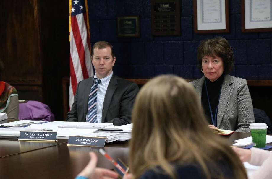 Superintendent of School Kevin Smith and Board of Education Chair Deborah Low at a board meeting in January. Smith says it is too early to decide how students will be graded with distance learning. Photo: Jarret Liotta / Hearst Connecticut Media / Wilton Bulletin