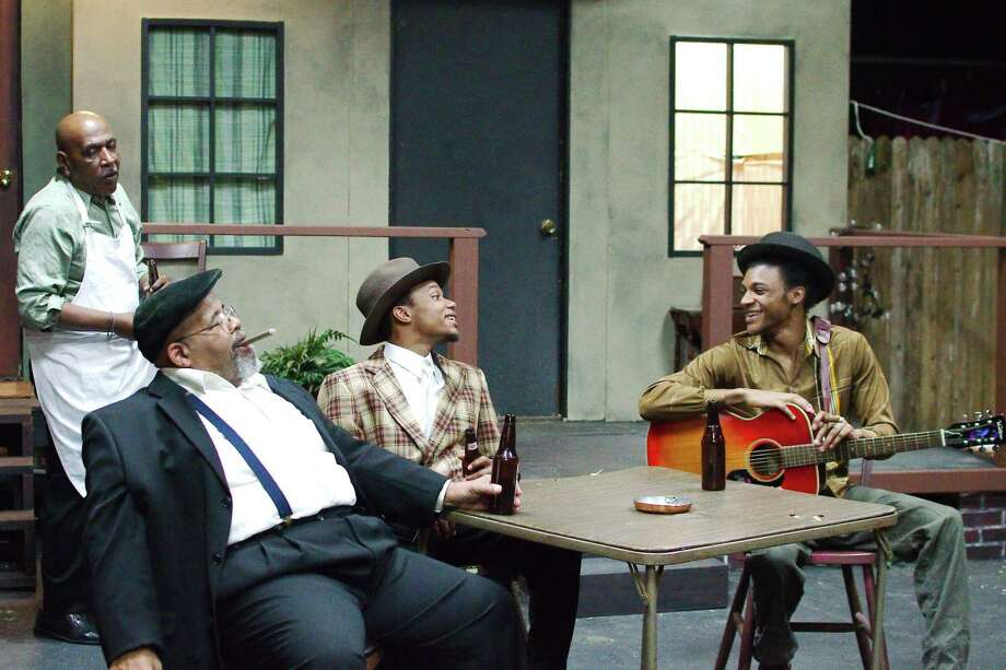 "VonFrederick Gipson, right, portrays a blues musician who is killed just as his career is about to take off, in Pearl Theater's ""Seven Guitars."" Also in the show are James West, left, Ray Walker and Justin Colfield. The show runs Feb. 7-23 as the theater's Black History Month. Photo: Kirk Sides / Staff Photographer / © 2020 Kirk Sides / Houston Chronicle"