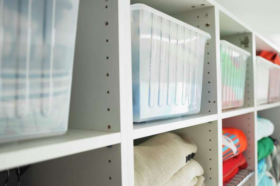 **FOR USE WITH AP LIFESTYLES** This undated photo provided by IKEA shows the Vessla storage crates on shelves. Clear, stackable plastic bins in all sizes are great for toys and clothing, says designer Katie Stassi. Kids can see inside, so they won't need to dump out several bins to find a favorite toy. Large bins can be stacked in closets, small ones kept on bookshelves. (AP Photo/IKEA) **NO SALES** Photo: AP / IKEA