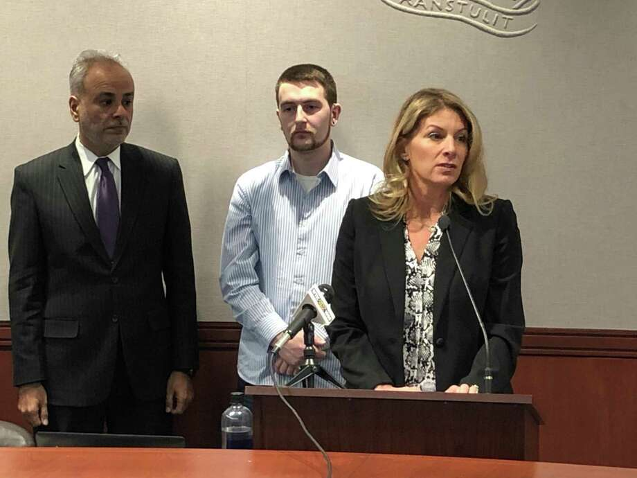 Andrea Ferrucci, chairwoman of the CT Community Nonprofit Alliance, joined by Sen. Saud Anwar of South Windsor (far left) and Chris Westphal, a patient at a Waterbury nonprofit agency. Photo: Keith M. Phaneuf / CTMirror.org