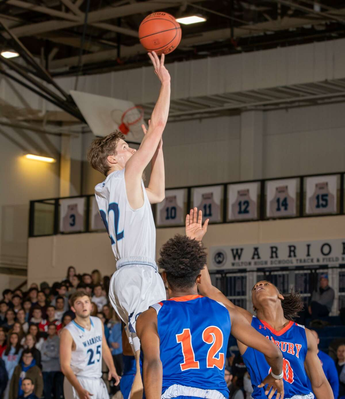 Andrew Smith rises for a jump shot during Wilton's win over Danbury on Thursday night.