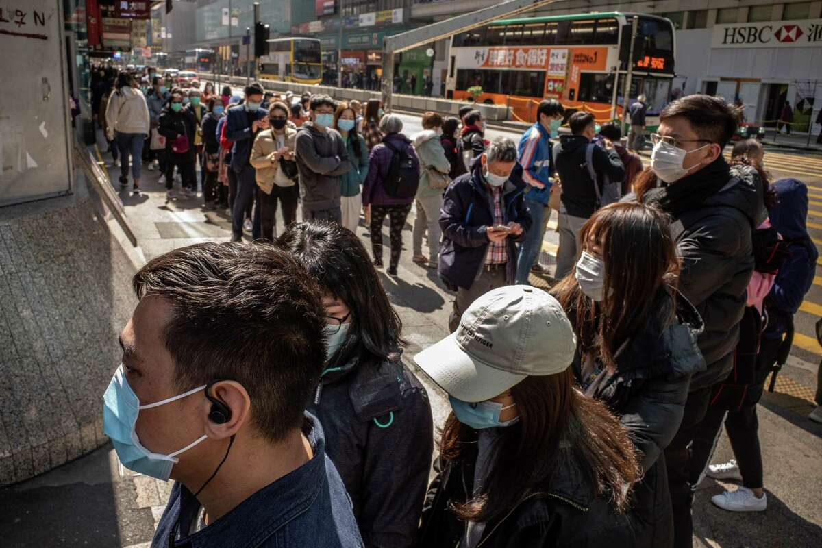 HONG KONG, CHINA - JANUARY 31: Residents line up to purchase face mask outside of a pharmacy on January 31, 2020 in Hong Kong, China. Hong Kong faces supply issues of surgical mask amid the coronavirus crisis. The WHO declared a global public health emergency with over 9800 confirmed cases of Novel coronavirus (2019-nCoV) around the world which most of them were in mainland China, where the virus claimed over 200 lives. (Photo by Anthony Kwan/Getty Images)