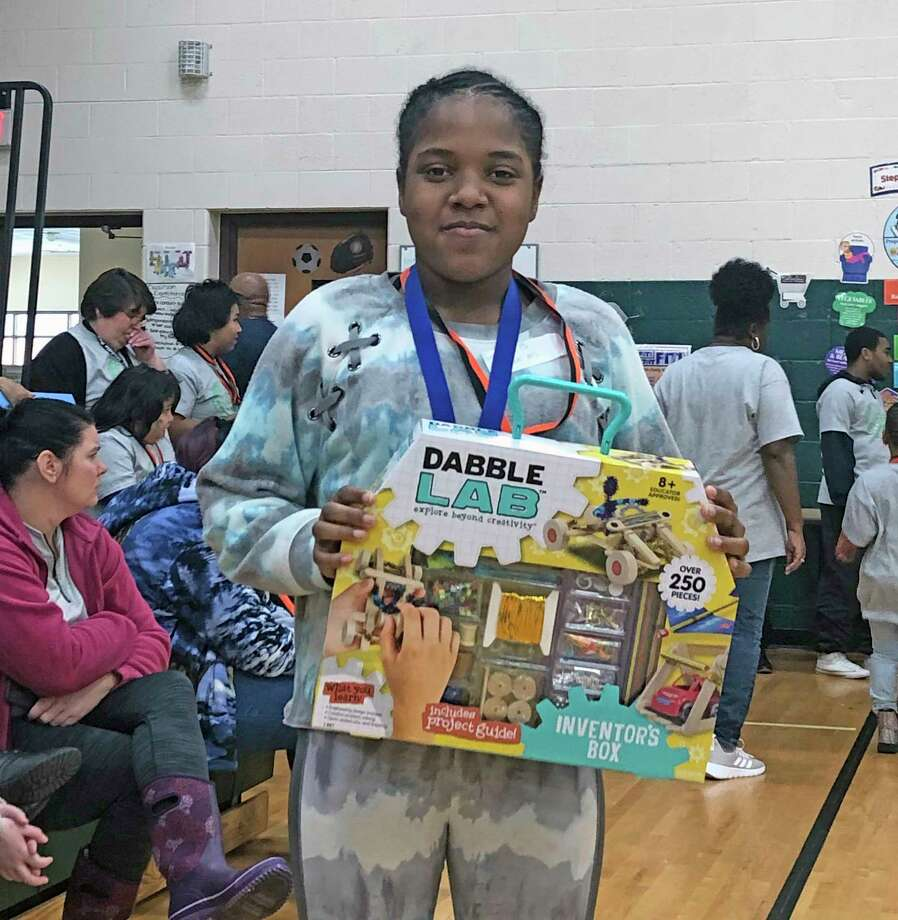 Baldwin Junior High School student Jazlyn Carter is pictured with the door prize she won at the 2020 STEAM Challenge. (Courtesy photo/TrueNorth Community Services)