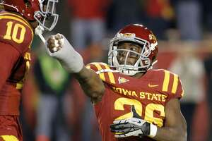 AMES, IA- OCTOBER 27: Defensive back Deon Broomfield #26 of the Iowa State Cyclones celebrates late in the fourth quarter after intercepting the ball from the Baylor Bears on October 27, 2012 at Jack Trice Stadium in Ames, Iowa. Iowa State defeated Baylor 35-21. (Photo by Matthew Holst/Getty Images)