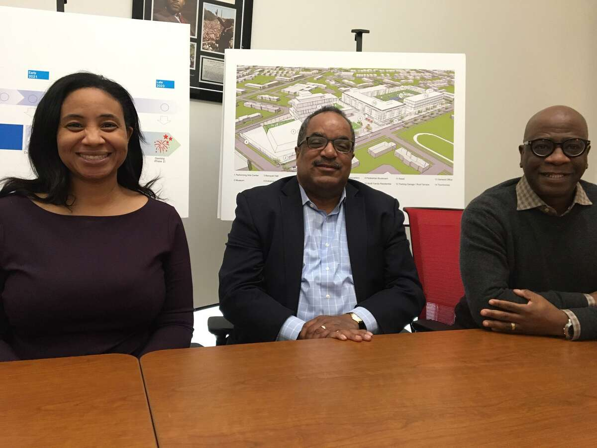 From left, Anna Blanding, Paul McCraven and Erik Clemons of ConnCORP explain its proposed $200 million makeover of Dixwell Plaza.