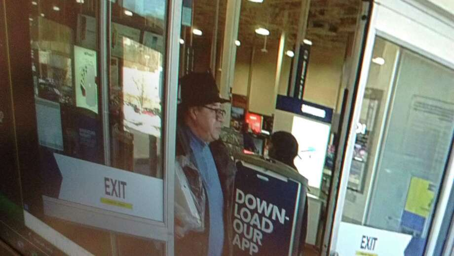 Newtown police are asking for the public's help to identify a man accused of using someone's credit card without authorization. Photo: / Contributed Photo
