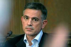 In this Dec. 4, 2019, file photo, Fotis Dulos, charged with murdering his estranged and missing wife, is questioned during testimony in a civil case at Hartford Superior Court in Hartford, Conn.