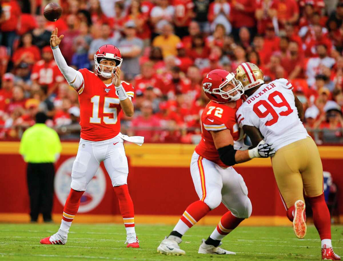 KANSAS CITY, MO - AUGUST 24: Patrick Mahomes #15 of the Kansas City Chiefs throws a 62-yard touchdown pass in the first quarter of a preseason game against the San Francisco 49ers at Arrowhead Stadium on August 24, 2019 in Kansas City, Missouri. (Photo by David Eulitt/Getty Images)