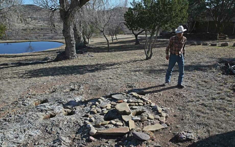 Bernal, 81, walks by grind holes that were used by ancient Indians on the property. Photo: Jerry Lara /San Antonio Express-News / **MANDATORY CREDIT FOR PHOTOG AND SAN ANTONIO EXPRESS-NEWS/NO SALES/MAGS OUT/TV   © 2019 San Antonio Express-News