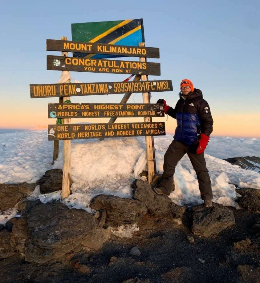 Manistee native Dominic Peterson poses at Uhuru Peak on Mt. Kilimanjaro during his climb to the peak. Peterson joined 23 others in climbing the mountain to help raise awareness and funds for the fight against Alzheimer's Disease. Photo: File Photo
