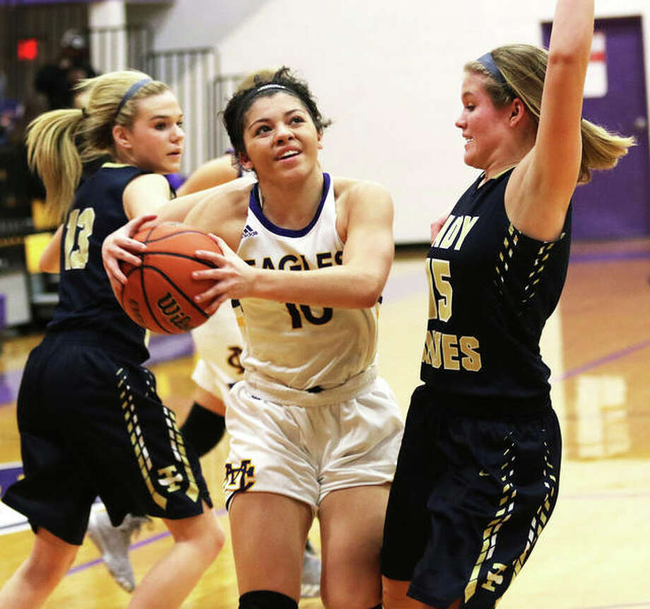 CM's Kourtland Tyus (middle) gets to the basket between two Teutopolis defenders in an Eagles victory Jan. 13 in Bethalto. On Thursday night, Tyus scored 17 points in a loss to Missouri power Incarnate Word in St. Louis. Photo: Greg Shashack / The Telegraph