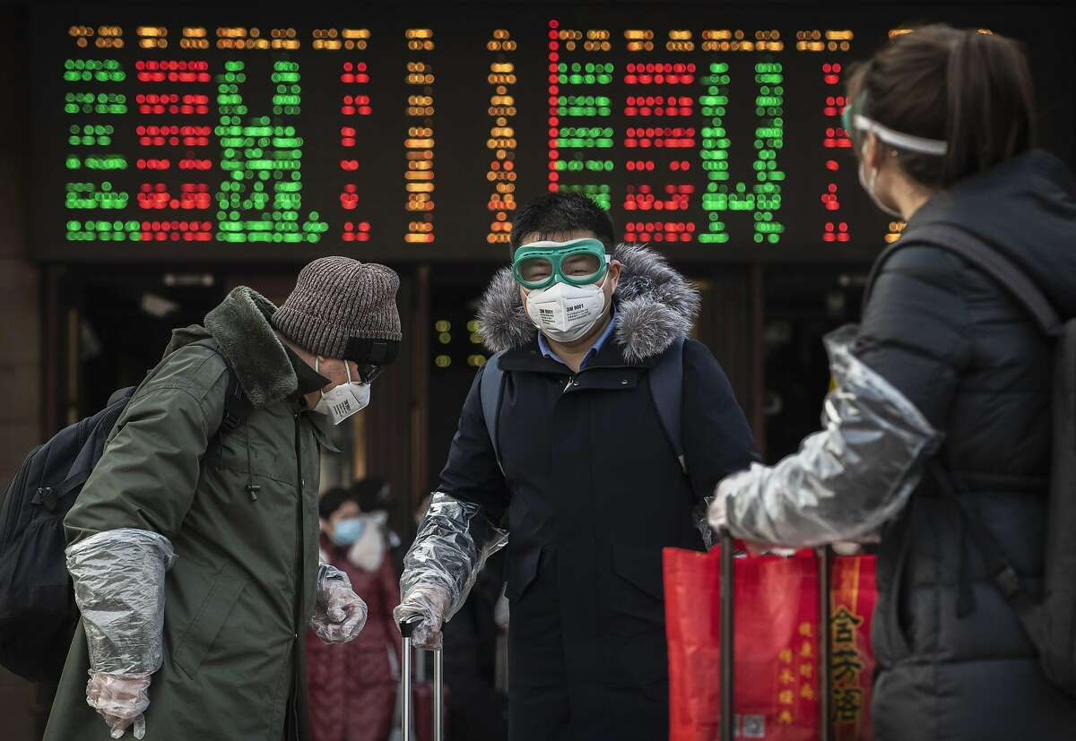 Chinese travellers wear protective masks and goggles after getting off a train as they and others return after the Spring Festival holiday on January 31, 2020 in Beijing, China. The number of cases of a deadly new coronavirus rose to almost 9700 in mainland China Friday, the day after the World Health Organization (WHO) declared the outbreak a global public health emergency. China continued to lock down the city of Wuhan in an effort to contain the spread of the pneumonia-like disease which medicals experts have confirmed can be passed from human to human. In an unprecedented move, Chinese authorities have put travel restrictions on the city which is the epicentre of the virus and neighbouring municipalities affecting tens of millions of people. The number of those who have died from the virus in China climbed to over 213 on Friday, mostly in Hubei province, and cases have been reported in other countries including the United States, Canada, Australia, Japan, South Korea, India, the United Kingdom, Germany, France and several others. The World Health Organization has warned all governments to be on alert and screening has been stepped up at airports around the world.