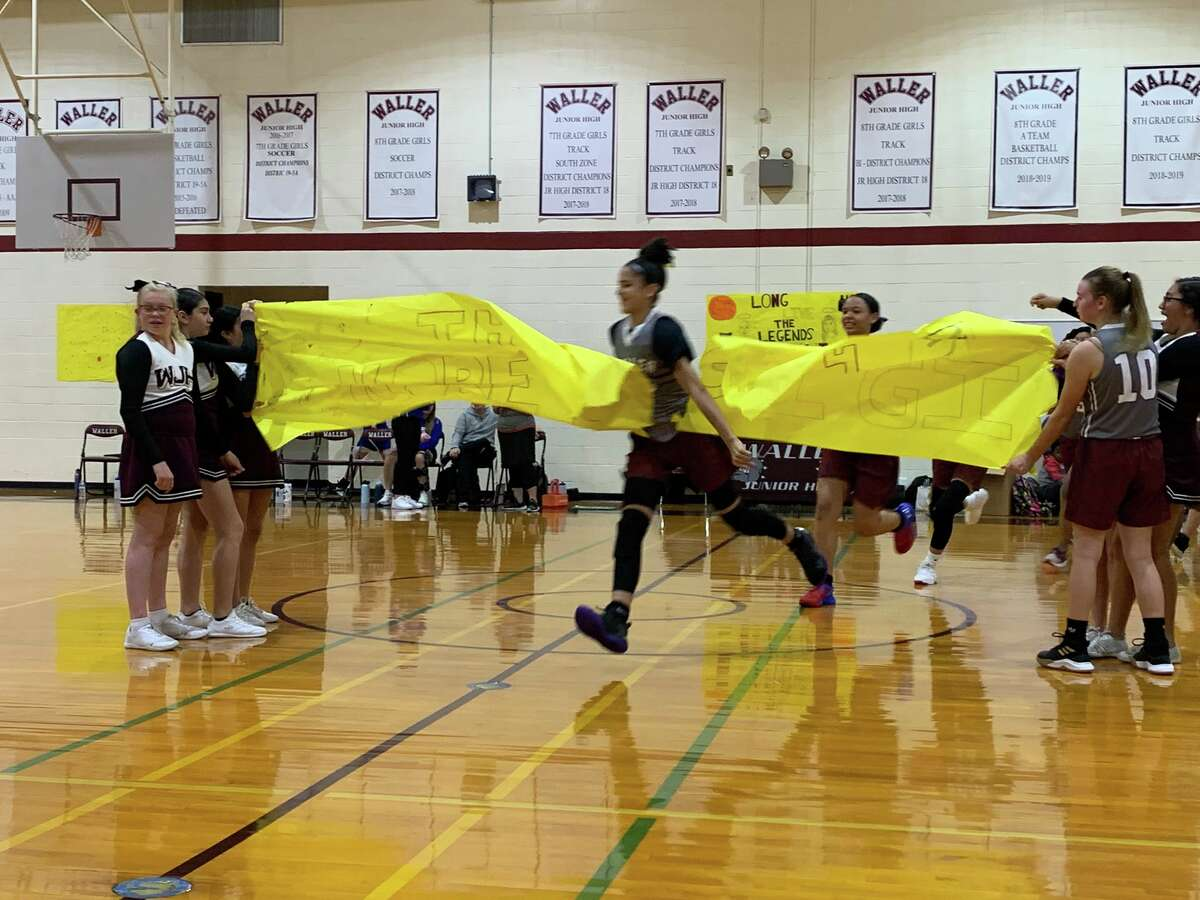 As the Waller Junior High 8th grade A team took the court against the Bear Branch middle school team, cheerleaders centercourt held up a banner reading