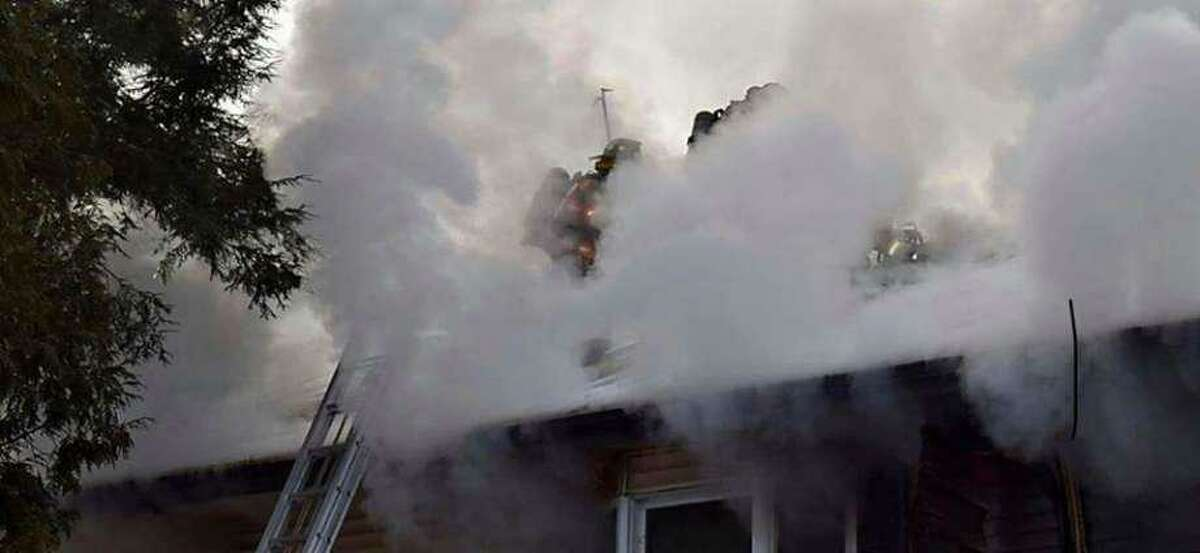 A house fire on Oak Ridge Road in Bethel, Conn., on the morning of Friday, Jan. 24, 2020.
