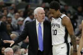 San Antonio Spurs head coach Gregg Popovich, left, talks with forward DeMar DeRozan (10) during the second half of an NBA basketball game against the Utah Jazz in San Antonio, Wednesday, Jan. 29, 2020. (AP Photo/Eric Gay)