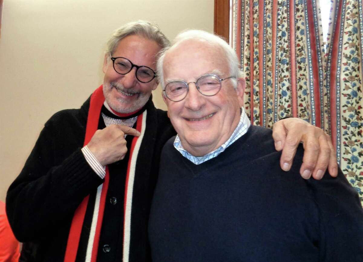 Sculptor Peter Woytuk, left, was enthusiastically welcomed by Kent Memorial Library Co-President Jim Blackketter, who said,
