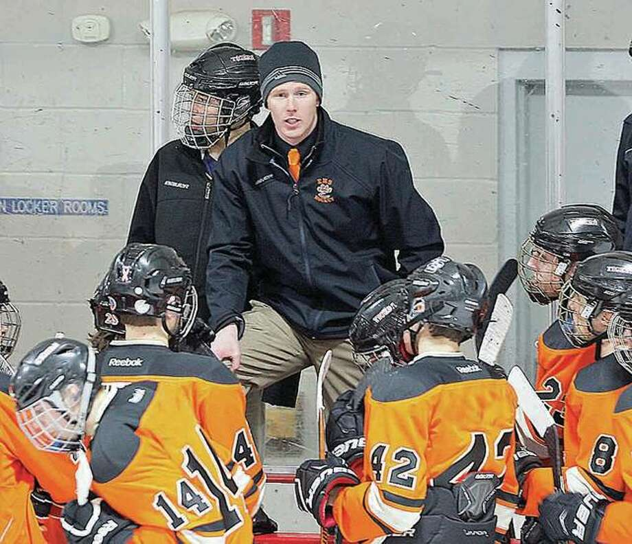 Edwardsville coach Jason Walker's team dropped a 2-1 decision to Rockwood Summit Thursday at the East Alton Ice Arena in the opening round of the Mid-States Hockey Association three-game round-robin playoffs.
