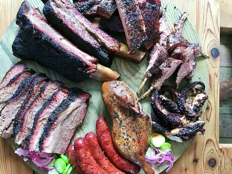 Chef Ara Malekian's smoked sampler at Harlem Road Texas BBQ includes, from top, pork ribs, lamb chops, octopus, duck, sausage, brisket and beef ribs.
