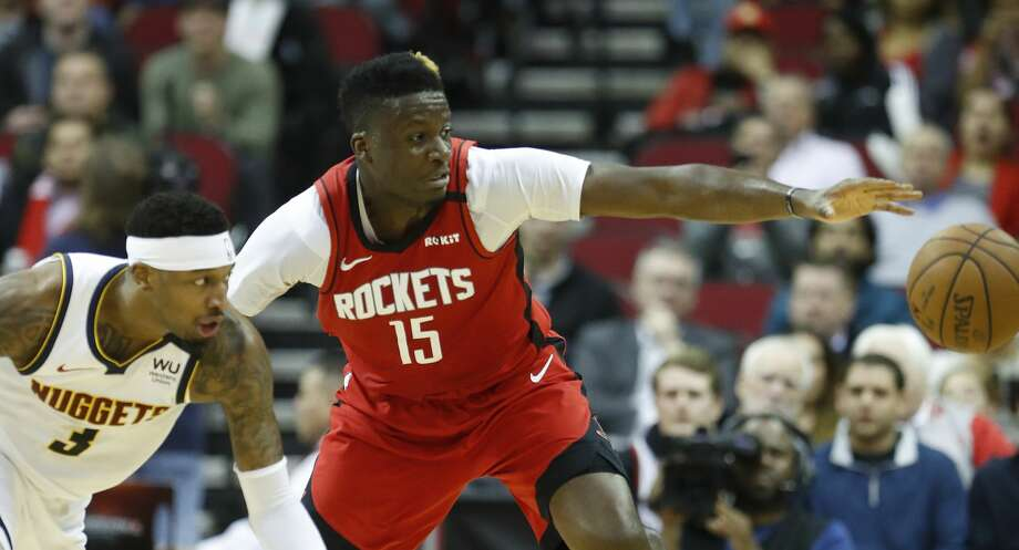 PHOTOS: 2019-20 Rockets game-by-game  Houston Rockets center Clint Capela (15) battles against Denver Nuggets forward Torrey Craig (3) for a loose ball during the second half of an NBA basketball game at Toyota Center in Houston, Wednesday, Jan. 22, 2020. >>>See how the Rockets have fared in each game this season ...  Photo: Karen Warren/Staff Photographer