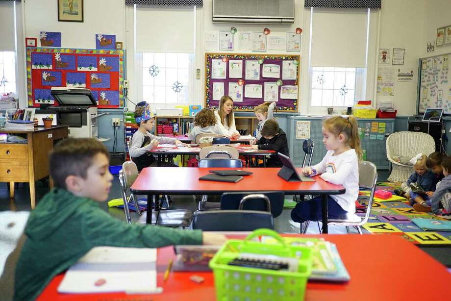 Teacher Sarah Lichorowiec, background, works with some students, as others work on their own in the Little Red Schoolhouse on Thursday, Jan. 30, 2020, in North Greenbush, N.Y.      (Paul Buckowski/Times Union) Photo: Paul Buckowski, Albany Times Union / (Paul Buckowski/Times Union)