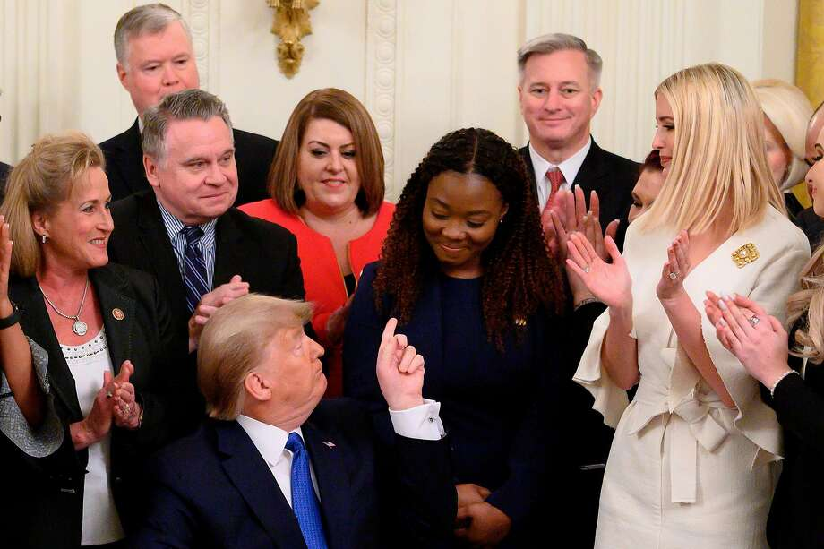 President Trump acknowledges Bella Hounakey, a survivor of human trafficking, after signing an executive order on combating human trafficking. Photo: Andrew Caballero-Reynolds / AFP Via Getty Images