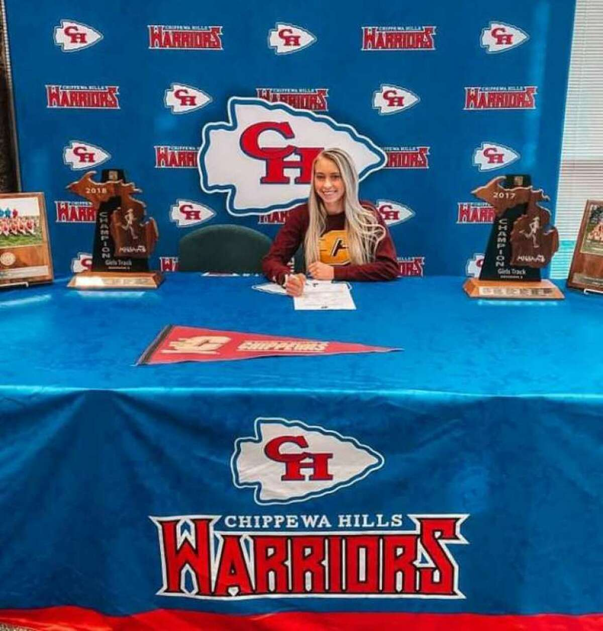 Chippewa Hills senior Natalie Newcombe signed her national letter of intent to run cross country and track and field at Central Michigan University in the fall.