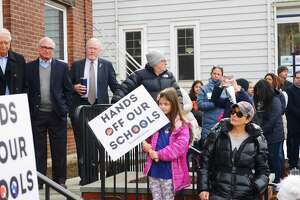 Members of Hands Off Our Schools protest in Ridgefield in February 2019, in opposition to bills proposed in the Connecticut legislature that would have forced schools to regionalize.
