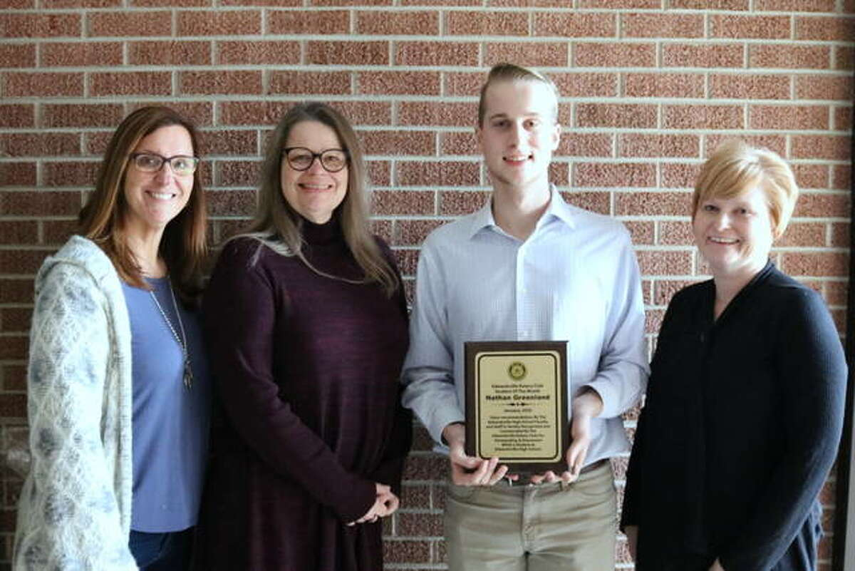 Left to right, Ann Tosovsky, rotarian, Grace Bannon, nominating teacher, Nathan Greenland and Tina Clanton, mother of Nathan.