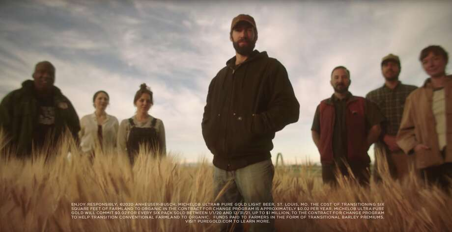 This undated image provided by Michelob ULTRA shows U.S. farmers in a scene from the company's 2020 Super Bowl NFL football spot. Michelob Ultra Pure Gold, promises to create more organic farmland for every six-pack sold. (Michelob ULTRA via AP) Photo: Associated Press
