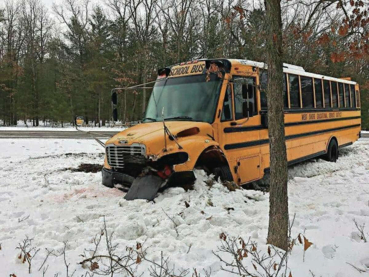 A West Shore Educational Service District bus was involved in a traffic crash Friday. A tractor trailer traveling east on US-10 at Peacock Trail lost control and hit the front of the bus pushing it off the road. No injuries were reported. (Courtesy photo)