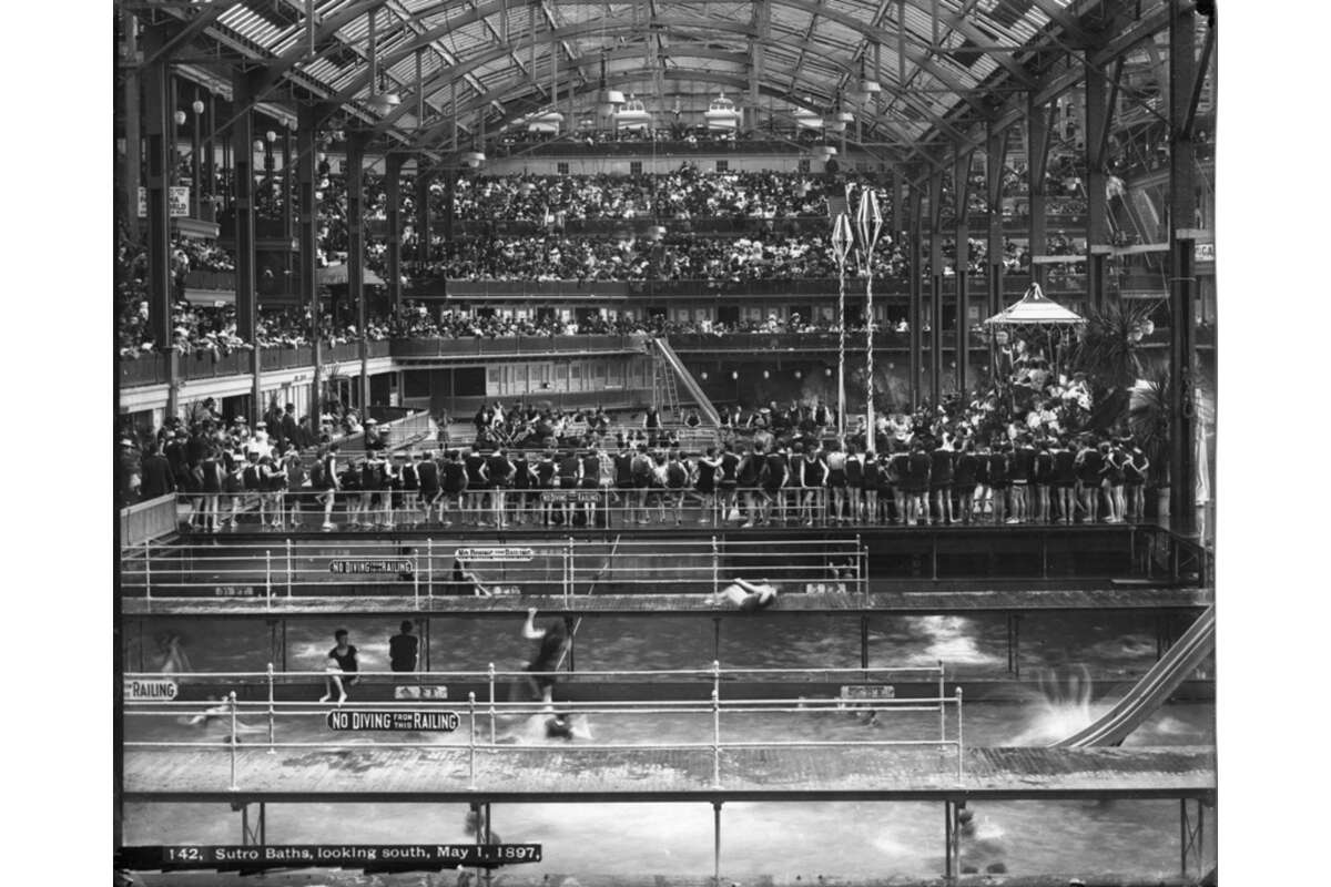 Before: Sutro Baths May Day at the Sutro Baths in 1897. The baths opened the year before and represented the largest indoor swimming pool complex in the world. It was complete with saltwater swimming pools, slides, swings, diving boards and more. But in 1966 the nearly 100-year-old structure ultimately closed and later went up in flames that same year.