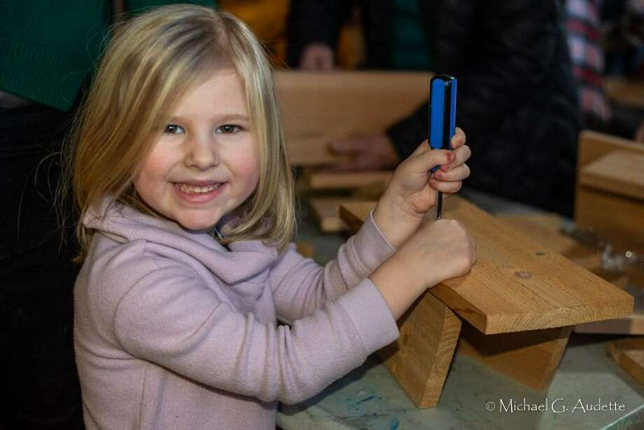 Flanders Nature Center is holding two bluebird nest box building programs this year on Feb. 15 and Feb. 29. Above, Emma Stirk shows her completed bluebird nesting box after a workshop at the nature center in Woodbury. Photo: Flanders Nature Center / Contributed Photo