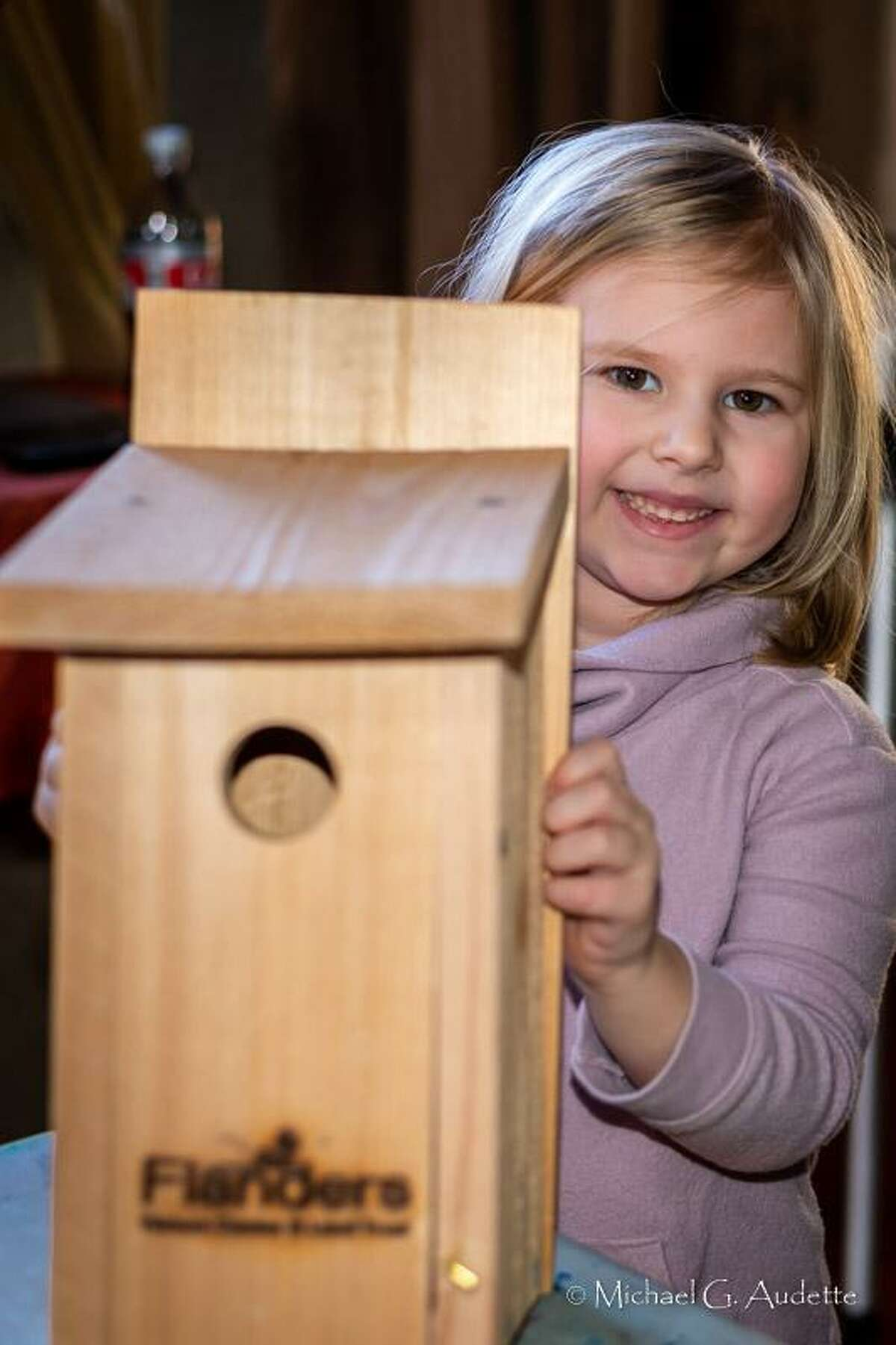 Flanders Nature Center is holding two bluebird nest box building programs this year on Feb. 15 and Feb. 29. Above, Emma Stirk shows her completed bluebird nesting box after a workshop at the nature center in Woodbury.