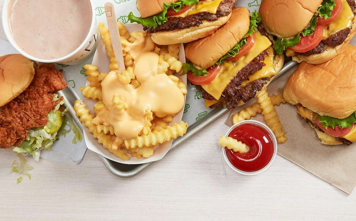 Burgers and fries from Shake Shack, which is opening its first outpost in Oakland this week.