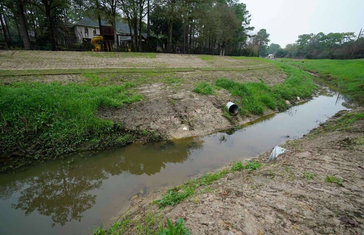 New drainage pipes along a tributary that flows into Cypress Creek are shown at Raveneaux County Club Friday, Jan. 17, 2020, in Spring. The Harris County Flood Control District bought part of the club property along Cypress Creek last week for a detention basin.