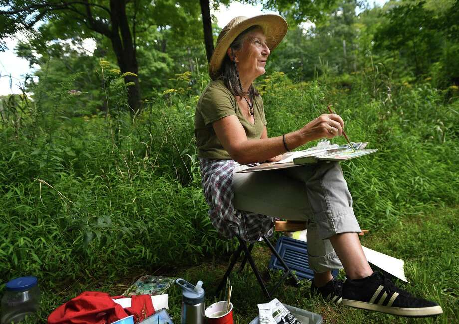 Francesca Monro, of Wilton, paints in a wildflower meadow during the Art in the Park Annual Festival at Weir Farm National Historic Site, in Wilton and Ridgefield, Conn. on Sunday, August 25, 2019. The site was the summer residence of American Impressionist painter J. Alden Weir. Photo: Brian A. Pounds / Hearst Connecticut Media / Connecticut Post