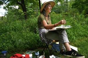 Francesca Monro, of Wilton, paints in a wildflower meadow during the Art in the Park Annual Festival at Weir Farm National Historic Site, in Wilton and Ridgefield, Conn. on Sunday, August 25, 2019. The site was the summer residence of American Impressionist painter J. Alden Weir.