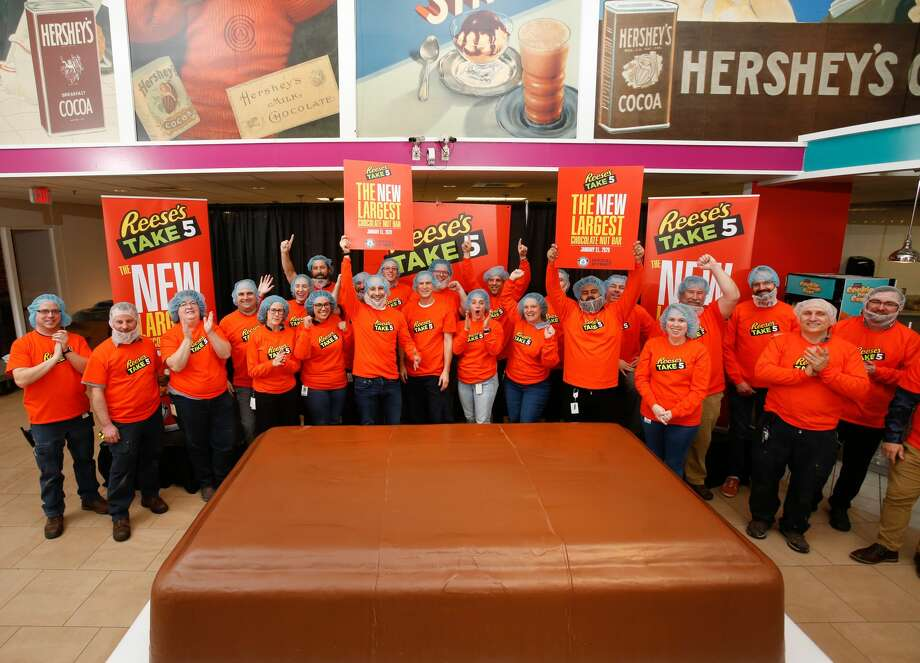 Reese's Take 5 may not be a household name yet, but this one will definitely be getting people's attention.  The bar measures 9 feet long by 5.5 feet wide by 2 feet high and weighs 5,943 pounds. and it only took 5 days to create, according to the release. Photo: Hershey / Copyright 2020 The Associated Press. All rights reserved