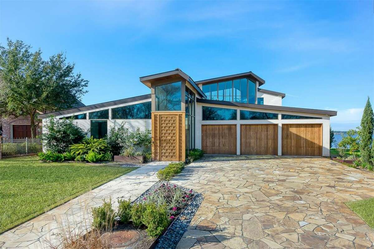 Located on Benthaven Island in Montgomery, this architectural gem offers sweeping views of Lake Conroe from nearly every room and just hit the market at $4.25 million.