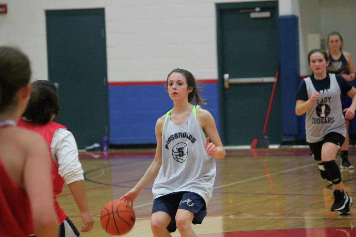 MacKenzie Cole handles the ball for Crossroads during a recent practice. (Pioneer photo/John Raffel)